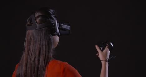 Lady-Gesturing-in-a-Virtual-Reality-Headset