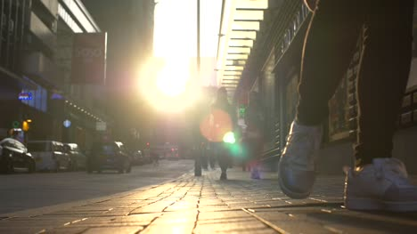 Low-Down-Shot-of-Sidewalk-at-Sunset