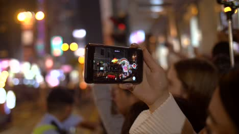 Filming-Parade-on-Smartphone