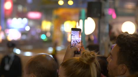 Person-Filming-New-Year-Parade-on-Phone