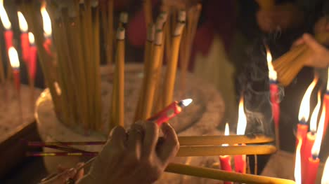 Lighting-Candles-and-Incense-in-Man-Mo-Temple