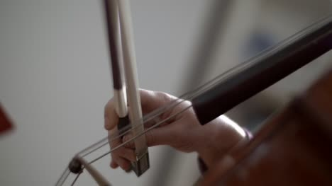 Bow-on-Cello-Strings-Close-Up