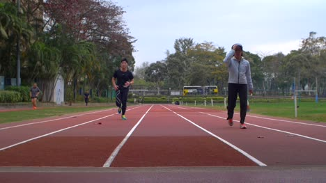 Low-Level-Shot-of-Runners-on-a-Track
