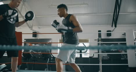 Young-Boxer-Training-with-Coach