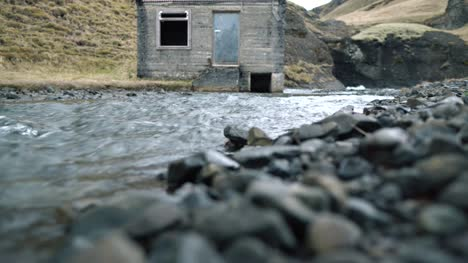 Low-Level-View-of-Hut-by-a-Stream