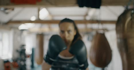 Woman-Boxer-Punching-Towards-Camera
