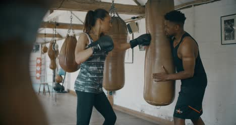 Man-and-Woman-Training-in-Boxing-Gym