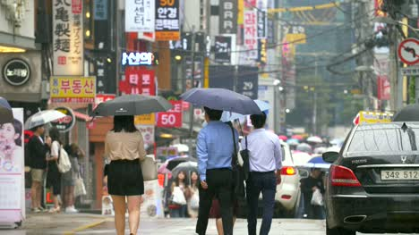 People-Walking-Down-Wet-Seoul-Street