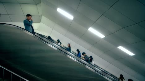 POV-Travelling-Up-an-Escalator