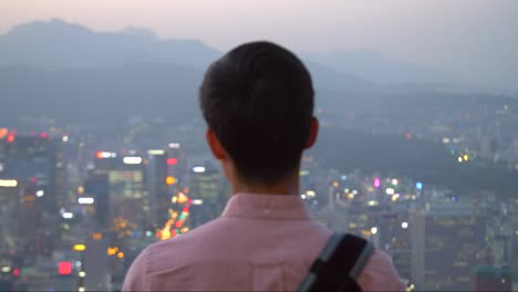 Man-Overlooking-Seoul