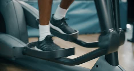 Mans-Feet-Whilst-Running-on-Cross-Trainer
