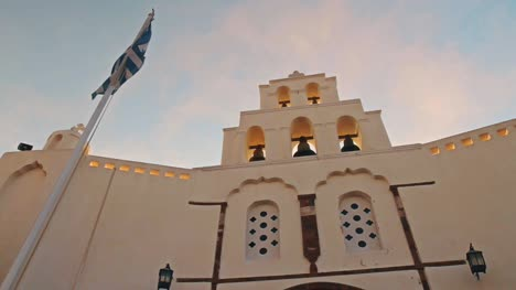 Time-Lapse-of-Bell-Tower-and-Greek-Flag