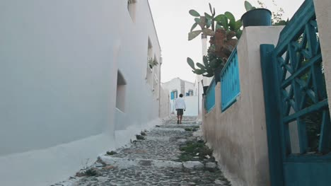 Man-Walking-Through-Greek-Side-Street