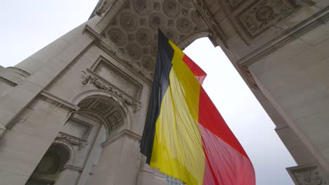 Belgian-Flag-Under-Triumphal-Arch-in-Brussels