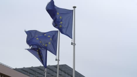 Three-EU-Flags-on-Flagpoles