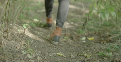 Low-Level-Shot-of-Walking-on-Country-Track
