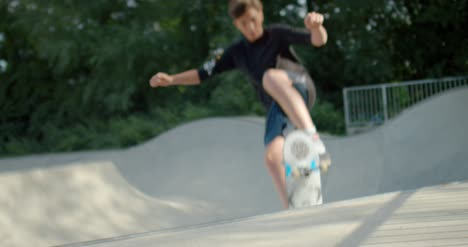 Skateboarder-Jumping-Out-of-Bowl-at-Skatepark