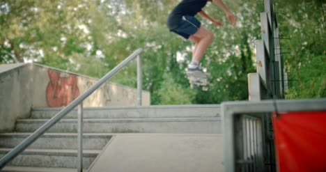 Skater-Jumping-Up-Steps-at-Skatepark