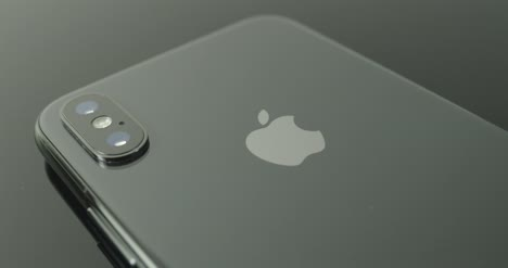 Static-Shot-of-Iphone-X-Camera-and-Logo