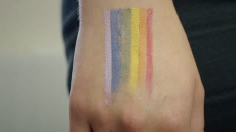 Tracking-Away-from-Pride-Flag-on-Hand