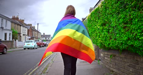 Walking-Down-Street-with-Pride-Flag