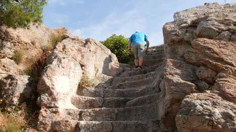 Tourist-Climbing-Steps-in-Athens