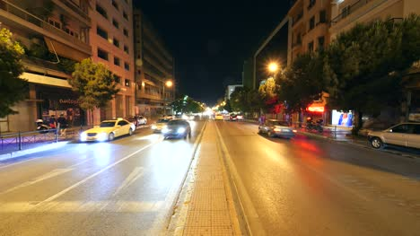 Looking-Down-Street-at-Night-in-Athens