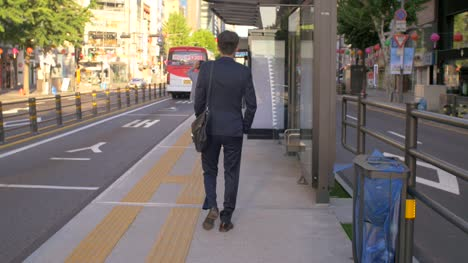 Businessman-Walking-to-Bus-Stop
