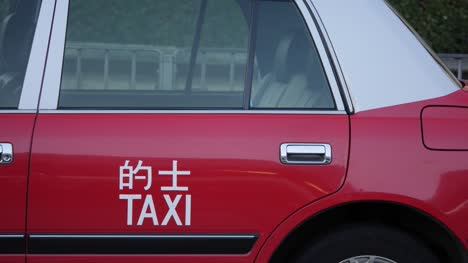 Red-Hong-Kong-Taxi-Side-View