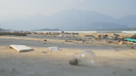 Light-Bulb-on-Rubbish-Filled-Beach