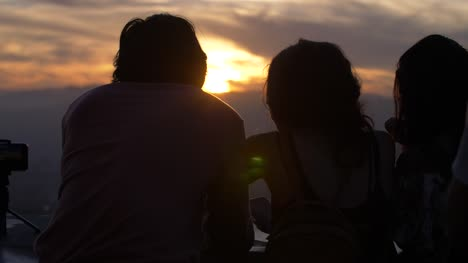 Young-Couple-Watching-Sunset