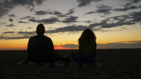 Meditating-Couple-at-Sunset