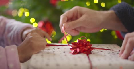 Closeup-of-Hands-Unwrapping-Present-Part-1