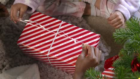 Top-View-of-Child-Unwrapping-Present