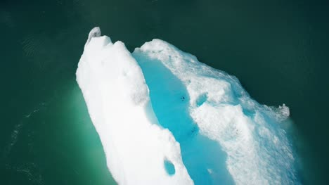 Flying-Over-Icebergs-in-Water