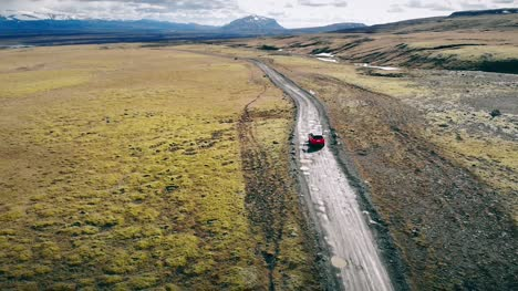 Red-Car-Driving-Through-Iceland-
