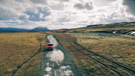 Red-Car-on-A-Dirt-Road