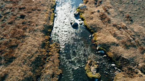 Flying-Over-Rocky-Stream