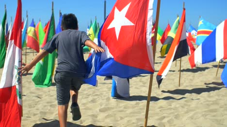 Child-Running-Through-National-Flags