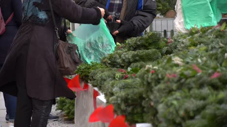 Woman-Buying-Christmas-Wreath