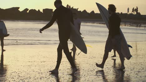 Surfers-Walk-To-Sea