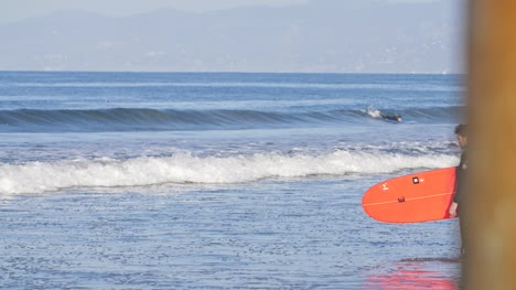 Surfer-with-Red-Surfboard