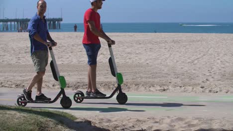 Men-on-Electric-Scooters-at-Venice-Beach