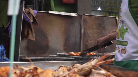 Vendor-Grilling-Shrimp-at-Food-Stall