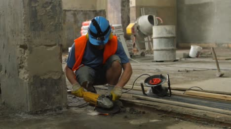 Construction-Worker-Using-Angle-Grinder