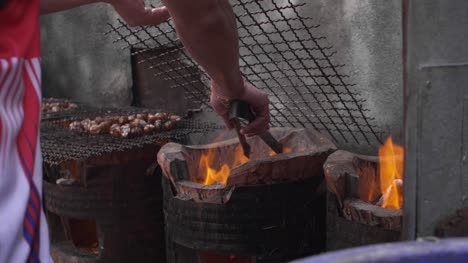 Vendor-Adjusting-Barbecue-Coals