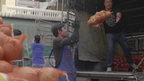 Men-Loading-Onions-on-Truck