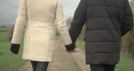 Couple-Holding-Hands-Walking-Away