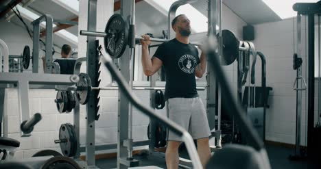Man-Squatting-with-Weights-in-Gym