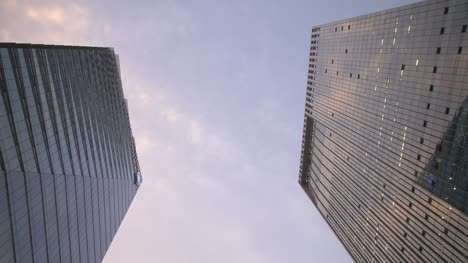 Looking-Up-Between-Two-Skyscrapers-Time-Lapse